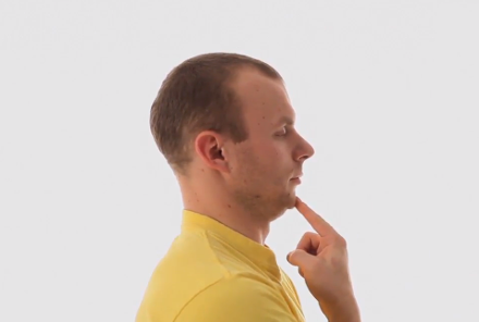 photo of man gently pressing on chin, moving head and neck out of forward flexed position